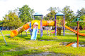Playground park on grass near school is children this Stock Photo