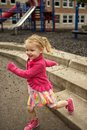 Playground prance young girl walking happy on the school Stock Photo