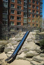 Playground slide among modern apartments for children Royalty Free Stock Image