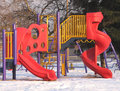 Playground slides in winter. Royalty Free Stock Photo