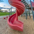 Playground with spiral slide and climbing frames Royalty Free Stock Photo