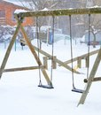 Playground swing image of a in the snow Royalty Free Stock Photography