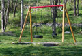 Playground with swings children s on green grass in may sweden Stock Photos
