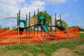 Playground under construction equipment that is blocked off with a orange fence Royalty Free Stock Image