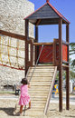 Playgrounds in park child girl jungle gym playground outdoor Royalty Free Stock Photo
