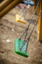 Playgroynd chain swing with shallow dof green Royalty Free Stock Photos