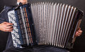 Playing the accordion close up musician against a black background Stock Image