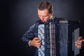 Playing the accordion young man with on a black background with copy space Stock Photography