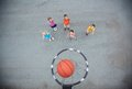 Playing basketball image of happy friends on sports ground Royalty Free Stock Image