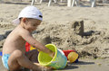 Baby boy playing with beach toys Royalty Free Stock Photo