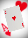 Playing card ace of hearts with a blurry background Stock Image