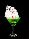 Playing card in a cocktail glass on black background. casino series Royalty Free Stock Photo