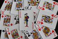 Playing card joker on the background of scattered cards Royalty Free Stock Photo