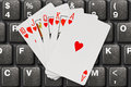 Playing cards on computer keyboard Royalty Free Stock Photo