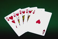 Playing cards on dark green background Royalty Free Stock Images