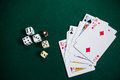 Playing cards and dices on poker table Royalty Free Stock Photo