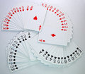 Playing cards of hearts, diamonds, clubs, spades Stock Photography