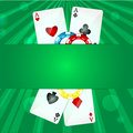 Playing cards and poker chips on a green background Royalty Free Stock Photos