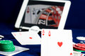 Playing cards reflected in computer screen Royalty Free Stock Photo