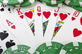 Playing cards (royal flush) and casino chips Royalty Free Stock Photo