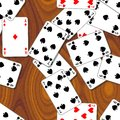 Playing cards scattered on the wooden table - seamless pattern texture background Royalty Free Stock Photo