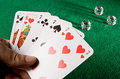 Playing cards showing a fullhouse and dice on green Royalty Free Stock Image