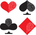 Playing cards suits illustration of red and black openwork with cut out carved pattern hearts spades clubs diamonds Royalty Free Stock Image
