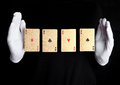 Playing cards trick with ace hands with gloves Royalty Free Stock Photo