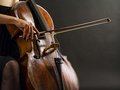 Playing the cello photo of an unrecognizable female musician a Royalty Free Stock Images