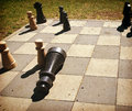 Playing chess game outdoors in the park board stalemate and king resigns retro effect instagram like added Royalty Free Stock Image