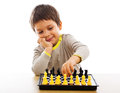 Playing chess young boy with pieces by himself Stock Photo