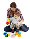 Playing with cubes mother and son colorful sitting on floor Royalty Free Stock Photography