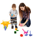 Playing with cubes mother and son colorful sitting on floor Royalty Free Stock Image