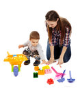 Playing with cubes mother and son colorful sitting on floor Stock Photo