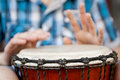 Playing on djembe young man shallow depth of field for emphasis a musical instrument Royalty Free Stock Photography
