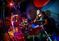 Playing drums musician on stage rock music concert Royalty Free Stock Photography