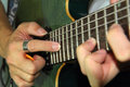 Playing electric guitar with tapping technic close up to the man Stock Images