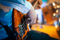 Playing electrical bass guitar Royalty Free Stock Photo