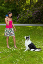 Playing fetch with a border collie dog smiling woman the ball her Royalty Free Stock Photography