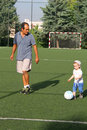 Playing football with dad happy family boy Royalty Free Stock Images