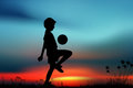 Playing football silhouette children on meadow and sunset Stock Photography