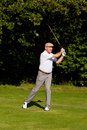 Playing Golf – hit the ball Stock Image