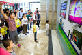 Playing interactive games with kinect xbox liuzhou china november a little girl the video in a shopping mall Royalty Free Stock Image
