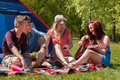 Playing music on a camping young teenager group are having their holliday Royalty Free Stock Images
