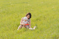 Playing music toy mother and daugther in grass Stock Images