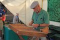 USA, AZ: Playing an Old-time Hammered Dulcimer Royalty Free Stock Photo