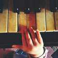 Playing the piano small baby hand Stock Photography