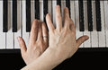 Playing the piano women s hands close up Stock Images