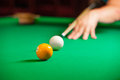 Playing pool close up of someone aiming the billiard ball with cue Stock Photo