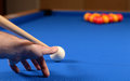 Playing pool a player taking a shot on a game Royalty Free Stock Photography